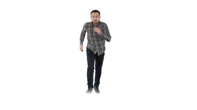 Man in casual speeding up and starts running fast on white background Full length portrait. Man in casual speeding up and starts running fast on white background. Professional shot in 4K resolution. 004. You can use it e.g. in your commercial video, business, presentation, broadcast east stock videos & royalty-free footage