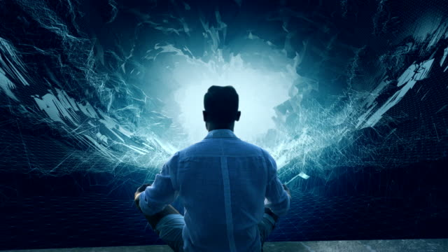 Man in digital tunnel. Meditating in virtual reality Virtual reality simulator. Man sitting in lotus pose looking inside the tunnel. Blue angular shapes levitation stock videos & royalty-free footage