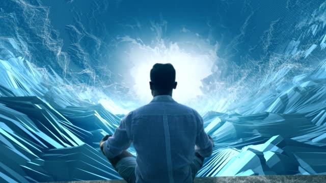 man in digital tunnel. meditating in virtual reality - голографический стоковые видео и кадры b-roll