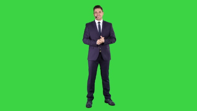 Man in formal clother with a headset presenting something on a Green Screen, Chroma Key