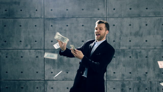 Man in formal suit dancing and throwing money video