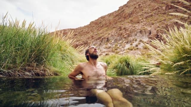 Man in hot spring in Atacama desert