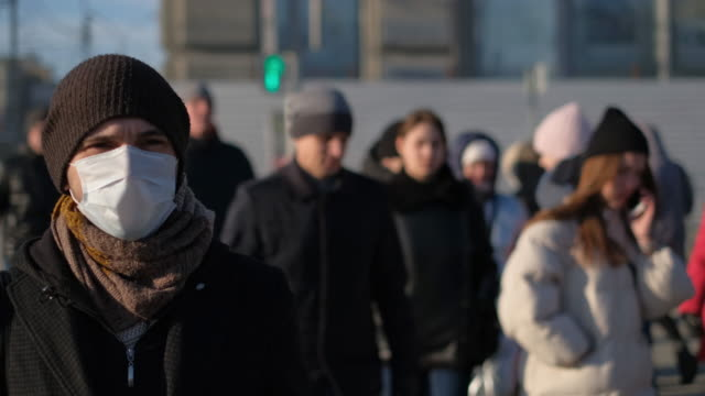 Man in mask coronavirus 2019-ncov. Corona virus covid-19. Environment pollution. video