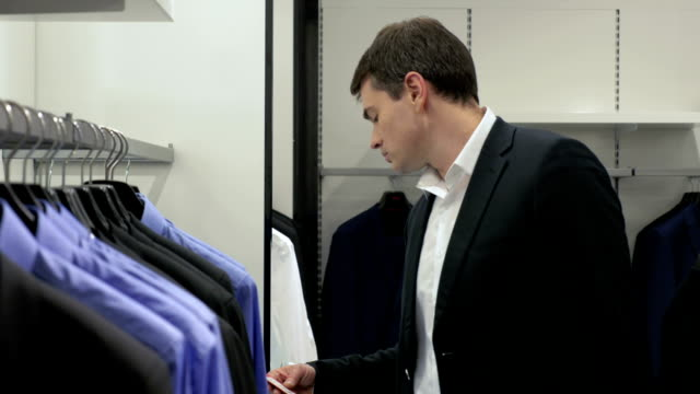 Man in Menswear Store video