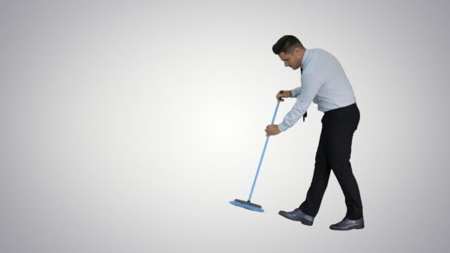man i officiella clother sopa golvet på gradient bakgrund - dirty money bildbanksvideor och videomaterial från bakom kulisserna