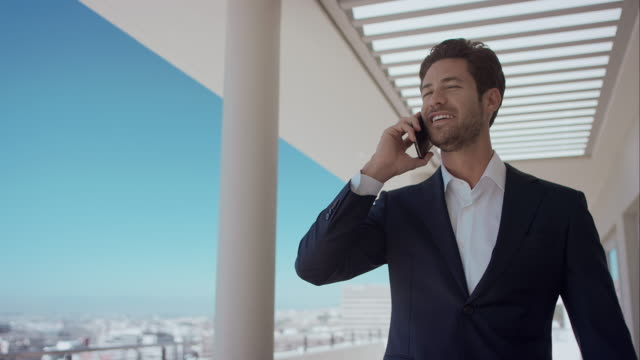 Man in penthouse talking on phone video