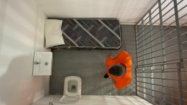4K AERIAL: Man in Prison / Jail Cell Pacing