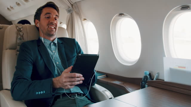 man in private jet airplane - business travel stock videos and b-roll footage