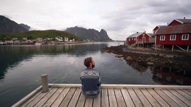 Man in Reine village in Lofoten Islands