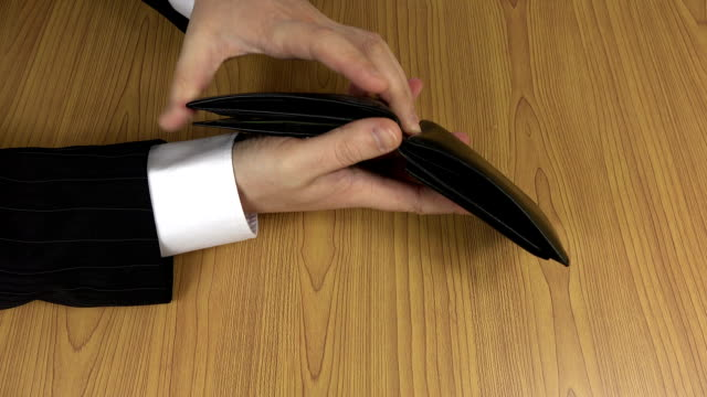 Man in suit hands check empty black leather wallet purse. FullHD video