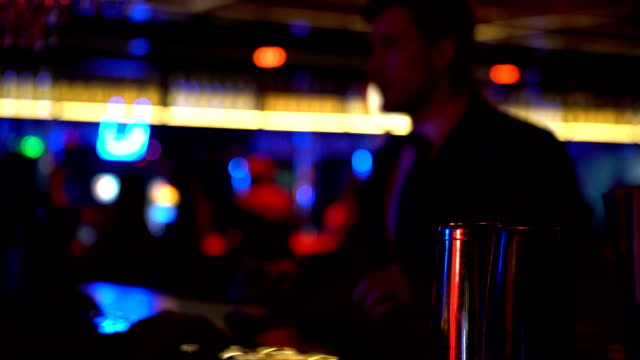Man in suit ordering drinks at bar counter, celebrating alone relaxed atmosphere video