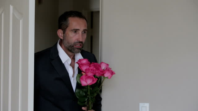 man in suit with a bouquet of flowers getting angry video