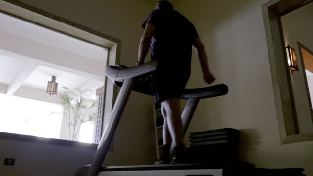 Man in the gym exercising on treadmill