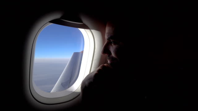 Man in the plane Man in the plane watching through the window plane stock videos & royalty-free footage