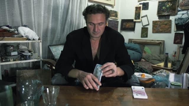 vídeos de stock e filmes b-roll de man in the room taking money from a dangerous money lender, usury and corruption concept - corruption