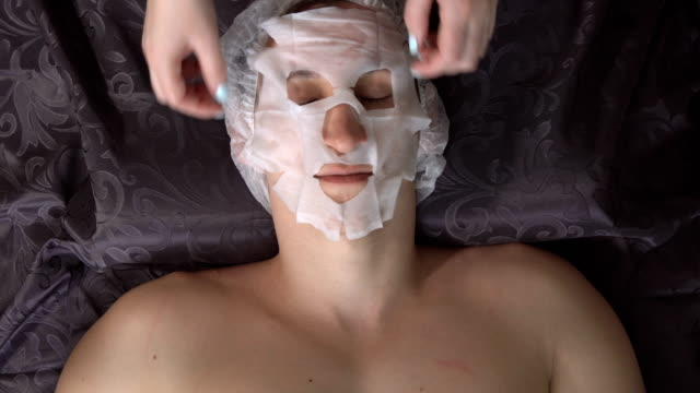 man in the spa taking a mask - facial stock videos & royalty-free footage