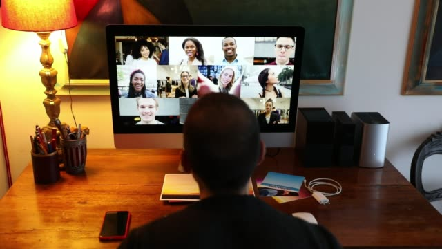 Man in Video call with friends and relatives in front of computer video