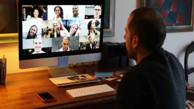 Man in Video call with friends and relatives in front of computer Family and friends happy moments in video conference in lockdown quarantine. multiple image stock videos & royalty-free footage