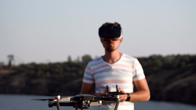 Man in VR glasses controlling drone video