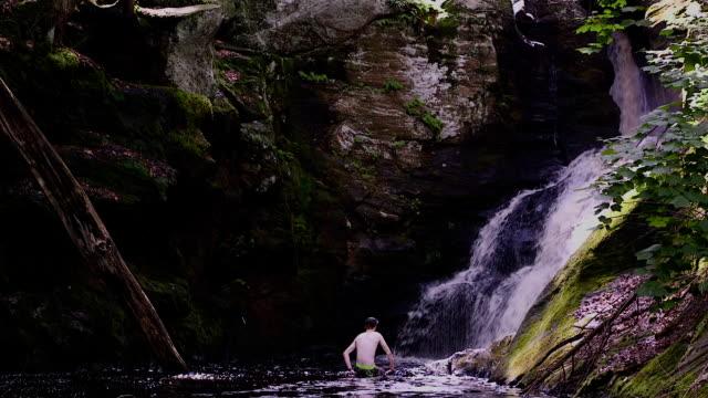 Man in Waterfall Base video
