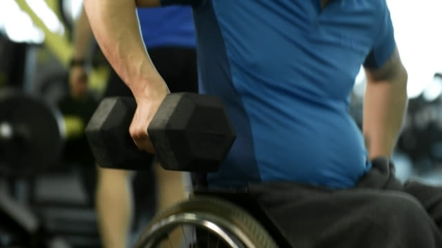 Man in Wheelchair Doing Dumbbell Rows video