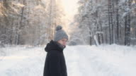 istock man in winter clothes walks through winter forest. Beautiful nature in Park. 1204240641