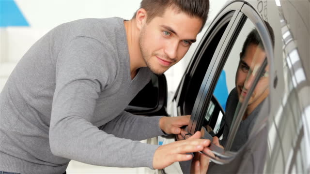 A man inspects his new car color video