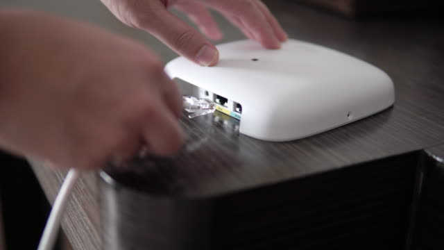 Man install CAT6 Ethernet network Patch Cable on router. Man install CAT6 Ethernet network Patch Cable on router. cable tv stock videos & royalty-free footage