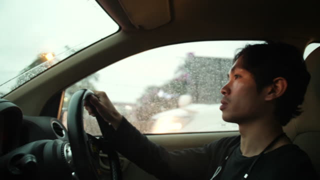 A man is driving a car in heavy rain and traffic jam asian man driving in heavy rain and traffic jam practice drill stock videos & royalty-free footage