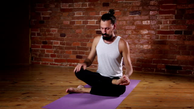 Man is engaged in yoga indoors video