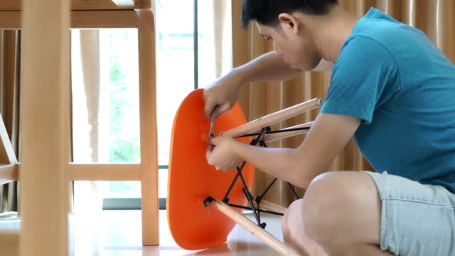 Man is installing DIY chair in the house video
