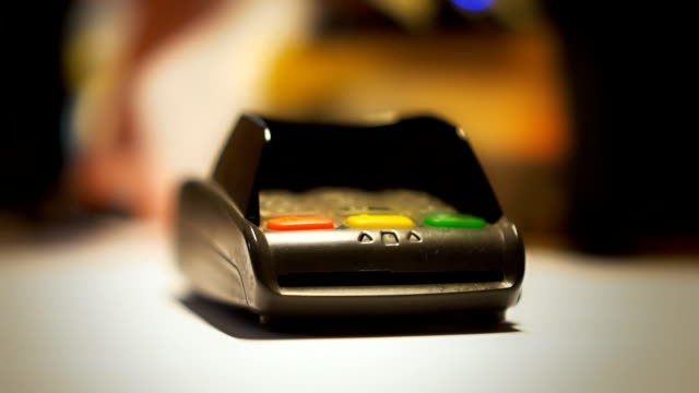 vídeos de stock e filmes b-roll de man is paying with contactless credit card. - paying with card contactless