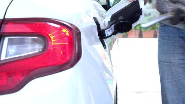 Man is Refuelling his car