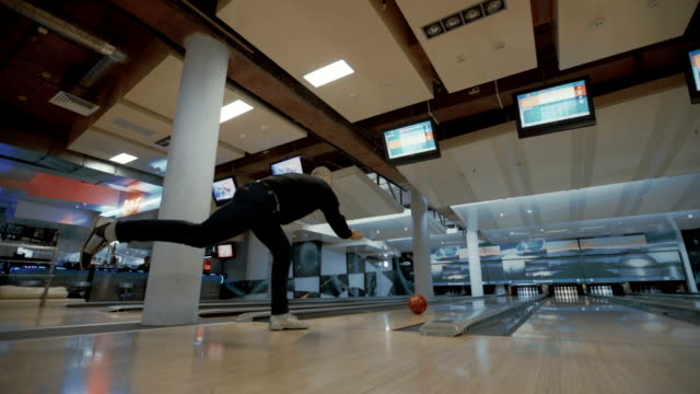 Man is throwing bowling ball video