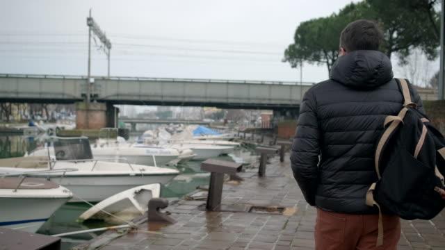 Man is walking along Via destra del port