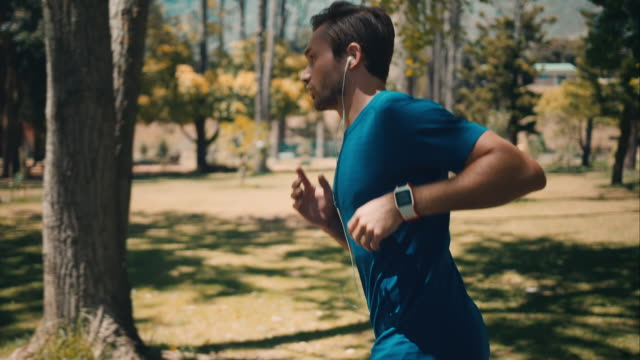 Man jogging in park video