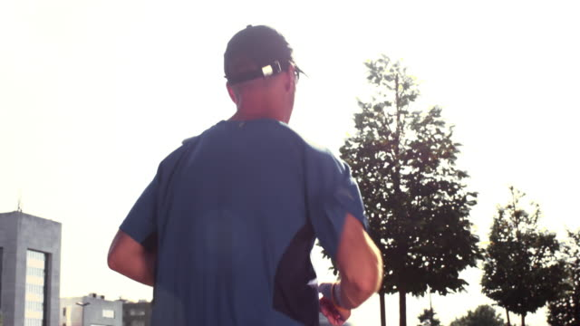 SLO MO TS Man jogging in the city video