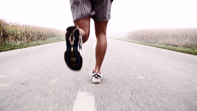 SLO MO Man Jogging In The Morning Mist video