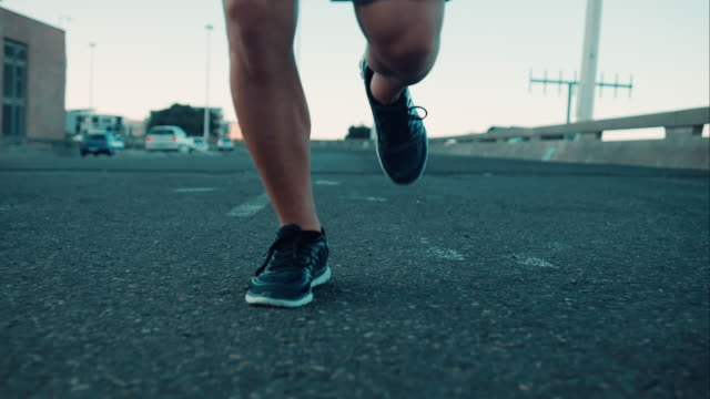 Man jogging in urban setting Selected Takes - Shot on RED Epic human foot stock videos & royalty-free footage