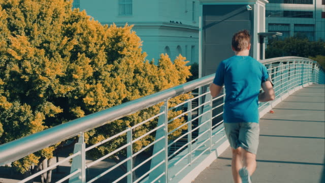 Man jogging on bridge video