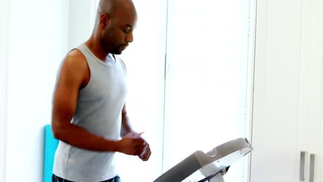Man jogging on treadmill 4k video