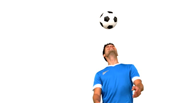 Man juggling a football with his head video