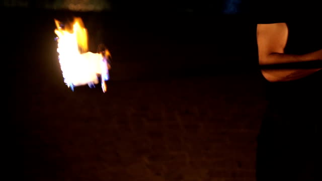 man juggling with fire,fire show performance man juggling with fire,fire show performance pyrotechnic effects stock videos & royalty-free footage