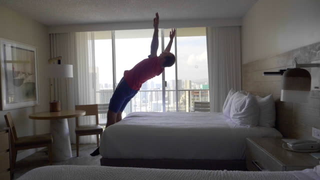 Man jumping on the bed in slow motion 180fps