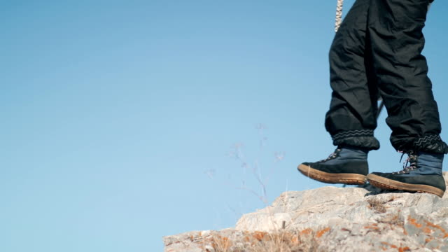 A man jumps off a cliff. Rope jumping. video