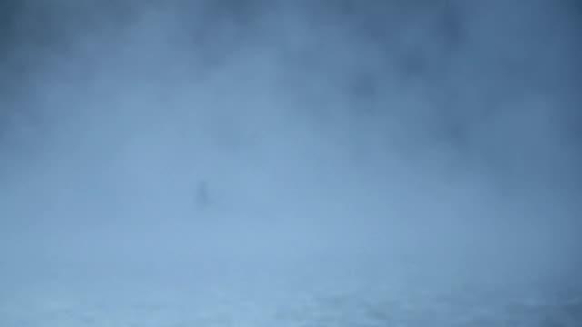 Man kayaking in the lake, misty foggy morning video