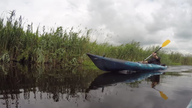 Man kayaking on the river video