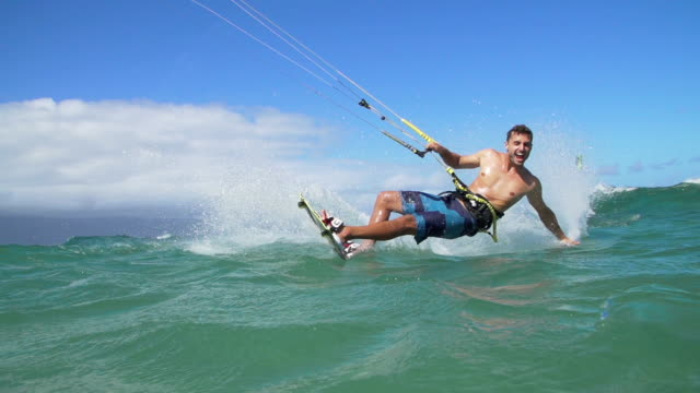 Man Kite Surfing In Ocean on Summer Day, Extreme Sport