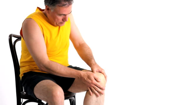Man Knee Pain A man who is experiencing severe pain in his knee. knee stock videos & royalty-free footage