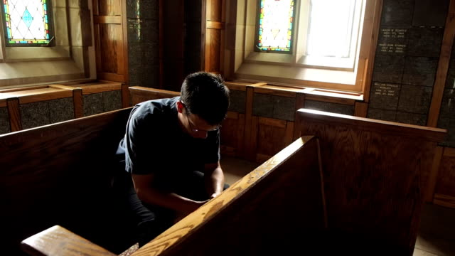 Man Kneeling In Prayer video